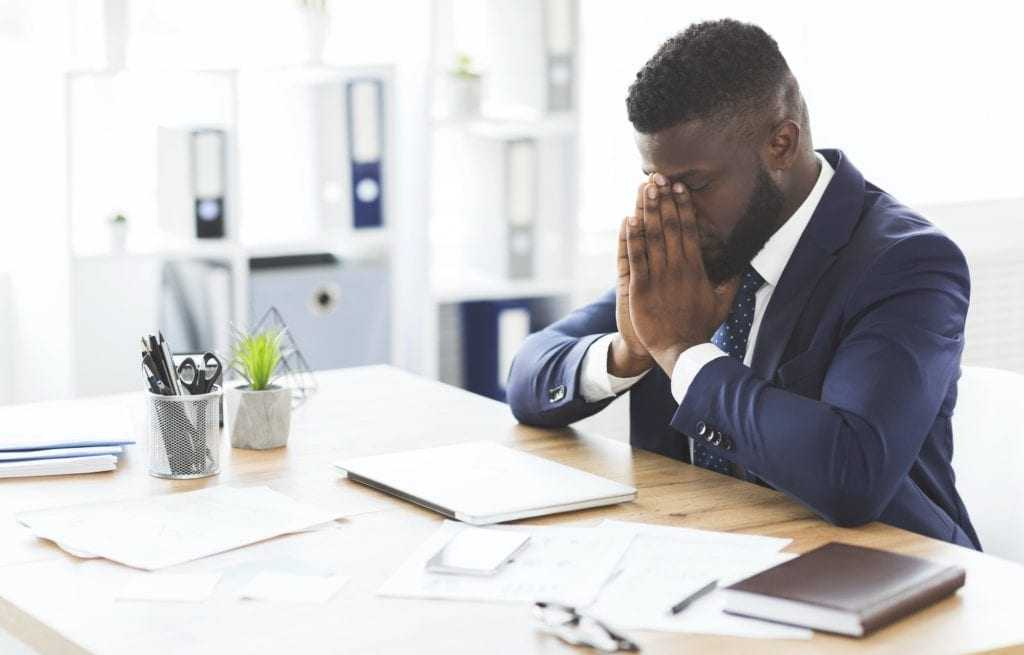 Young tired businessman having stress at work